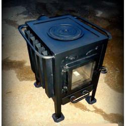 Печь - камин с плитой и со стеклянной дверцей